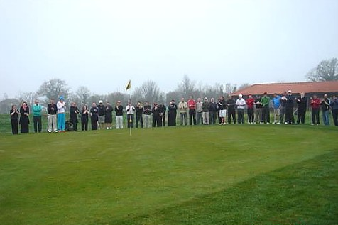 Members around the green watching the proceedings
